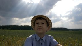 Dreamer boy in the hat looks at the beautiful sky. Have fun stock images
