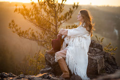 Dreamer woman meeting sunrise at the mountains Stock Image