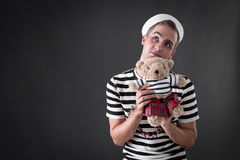 Dreamer in Wonderland. Sailor with teddy bear royalty free stock image