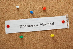 Dreamers Wanted. The phrase Dreamers Wanted typed on a piece of paper and pinned to a cork notice board Stock Photography