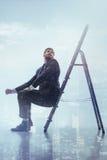 Dreamful businessman desiring higher business position royalty free stock photos