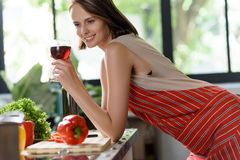 Dreamful lady enjoying drink in kitchen Royalty Free Stock Images