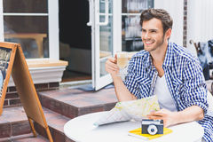 Dreamful traveler relaxing in cafeteria Royalty Free Stock Image