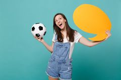 Dreamful woman football fan cheer up support team with soccer ball, empty blank yellow Say cloud, speech bubble isolated. On blue turquoise background. People royalty free stock image