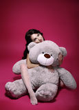 Dreaminess. Sentimental Girl with Soft Toy - Gray Bruin in Embrace. Dreamy Woman with Teddy Bear in Embrace posing Stock Images