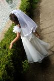 Dreaming. Girl walking in white wedding dress royalty free stock photos