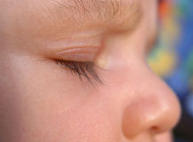 Dreaming. Closed baby eye, sleeping Stock Image