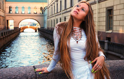 Dreaming. Young girl dreaming on the bridge near Winter Canal in St. Petersburg stock images
