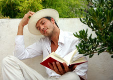 Dreaming. Closed eyes dreaming male with sombrero stock photo