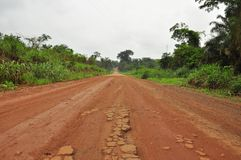 Dreaming of Africa. Red African endless road through the jungle Stock Photography