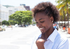 Dreaming african american woman in the city Royalty Free Stock Photo
