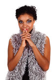 Dreaming African woman. Beautiful African woman dreaming with her hands clasped next to lips Royalty Free Stock Photos