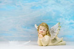 Dreaming angel on a blue background: greeting card for death, ch Stock Image