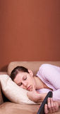 Dreaming away in front of TV Stock Photography