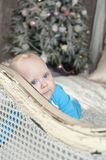 Dreaming baby and Christmas tree. Dreaming and smiling baby and Christmas tree Royalty Free Stock Images