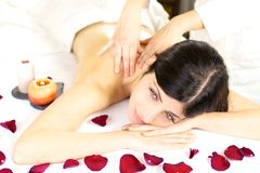 Dreaming during back massage in spa with flowers and candles Royalty Free Stock Photo