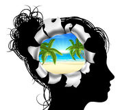 Dreaming of a Beach Vacation. A womans head in silhouette with a tropical beach vacation scene. Concept for thinking or dreaming about a tropical beach vacation Royalty Free Stock Image