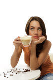 Dreaming beautiful woman with a cup of cappuccino Stock Photo