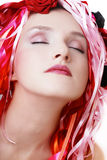 Dreaming beauty. Portrait of beautiful girl with closed eyes in wig of silk ribbons Stock Photos