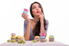 Dreaming beauty with confection. Dreaming beauty with different confection of various types and forms. Macarons from France, cupcakes with cool decoration on Royalty Free Stock Images