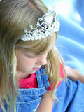 Dreaming of being a princess. A young girl wearing a princess crown Stock Image