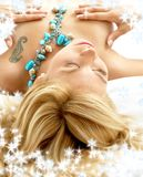 Dreaming blond in bed with snowflakes Stock Photography
