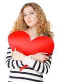 Blond girl with big red valentine card Royalty Free Stock Photo