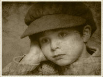 Dreaming boy. Portrait of dreaming boy in retro style with oldfashioned frame Stock Photo