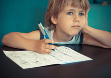 Dreaming boy during doing homework Royalty Free Stock Photos