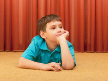Dreaming boy on the floor Stock Photo