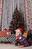 Dreaming boy in front of the christmas tree Royalty Free Stock Photography