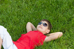 Dreaming boy on the grass Stock Photography