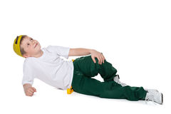 Dreaming boy is lying on the white Stock Images