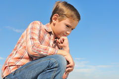 Dreaming boy at the sky Royalty Free Stock Photo
