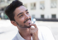 Dreaming brazilian guy in the city Royalty Free Stock Photo