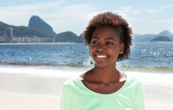 Dreaming brazilian woman at Copacabana beach Royalty Free Stock Image