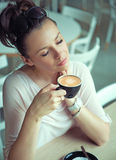 Dreaming brunette lady with cup of coffee Royalty Free Stock Photos