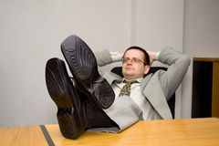 Dreaming about business. Satisfied businessman dreaming up the future - business concept - shallow depth of field - focus on shoes stock photography