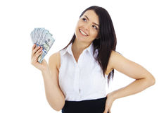 Dreaming business woman with cash in hand Royalty Free Stock Image