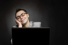 Dreaming businessman with laptop Royalty Free Stock Photos