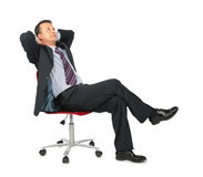 Dreaming businessman sits on office chair Royalty Free Stock Photos