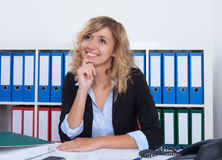 Dreaming businesswoman with curly blond hair Royalty Free Stock Photo