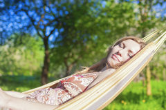 Dreaming Caucasian Blond Woman Resting in Hummock Outdoors. Stock Image