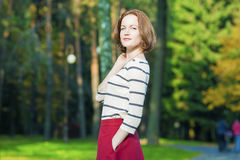 Dreaming Caucasian Brunette Woman in Fashion Clothing Posing in Royalty Free Stock Photos
