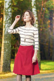 Dreaming Caucasian Brunette Woman in Fashion Clothing Posing in Stock Images
