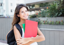 Dreaming caucasian female student in the city Stock Images