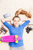 Dreaming cheerful teenage girl lying on the floor Royalty Free Stock Photos