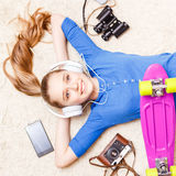 Dreaming cheerful teenage girl lying on the floor Royalty Free Stock Images