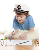 Dreaming child in captain cap Royalty Free Stock Images