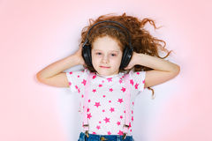 Dreaming child with headphones listening to music Royalty Free Stock Photography
